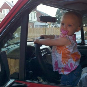 The reason for everything. She loves daddy's trucks